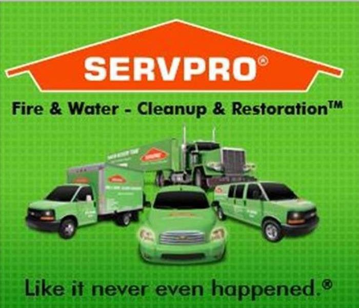Green SERVPRO trucks and orange logo